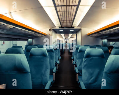 Blank space of chair back, inside high speed train compartment. An interior view of a modern intercity train in China - Stock Photo