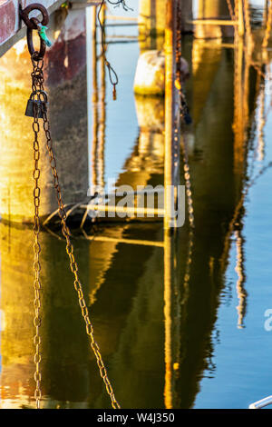 Mooring chain with padlock hanging from the pier of the Kladovo Marina, Danube River, Serbia - Stock Photo