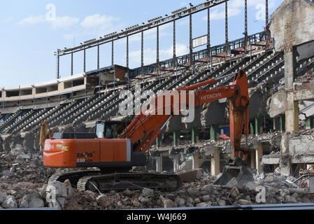 Workers clean up debris as demolition continues at the Vicente Calderon in Atletico de Madrid old stadium.Vicente Calderon stadium was named after the club's former president and it was opened in October 1966 in the south of the city, on the Manzanares River. It has hosted the Atletico de Madrid's matches for over 50 years, until their move to the Wanda Metropolitano in 2017. - Stock Photo