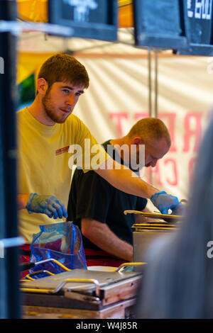SHEFFIELD, UK - 20TH JULY 2019: Members of Steet Food Chef cook food for people during Sheffield Tramlines Festival - Stock Photo