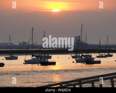 Queenborough, Kent, UK. 23rd July, 2019. UK Weather: this evening's sunset in Queenborough, Kent at the end of a hot and humid day. Credit: James Bell/Alamy Live News - Stock Photo