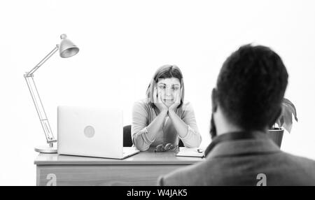 Interview for a job. Human resource manager conducting job interview with applicant. Pretty interviewer asking interview questions to job candidate. Man having job interview in company HR department. - Stock Photo