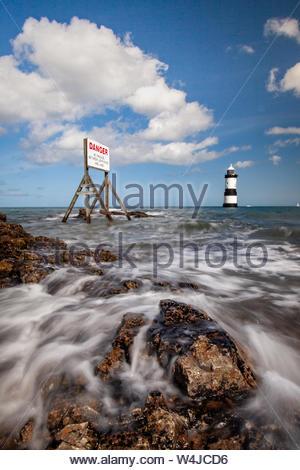 Trwyn Du (Penmon Point) Lighthouse at High Tide - Stock Photo