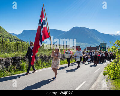 Procession on norwegians national day 17th of May, children of Kindergarten and school, traditional clothing, village Solvorn, Sognefjord, Norway. - Stock Photo