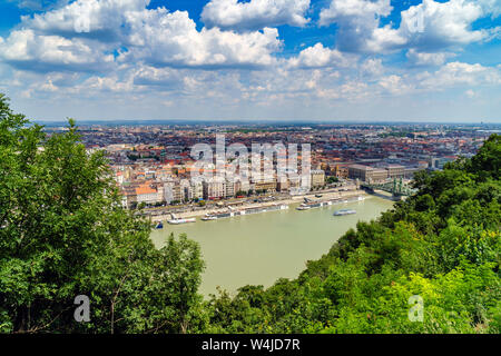 Panorama of Budapest over the Danube river. The bridges destroyed in World War II touch the two parts of the city Buda and Pest. The bridges stand out - Stock Photo