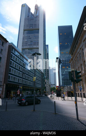 Frankfurt, Germany - July 06, 2019: Various skyscrapers like the Commerzbank skyscraper in the city center in backlight on 06 July 2019 in Frankfurt. - Stock Photo