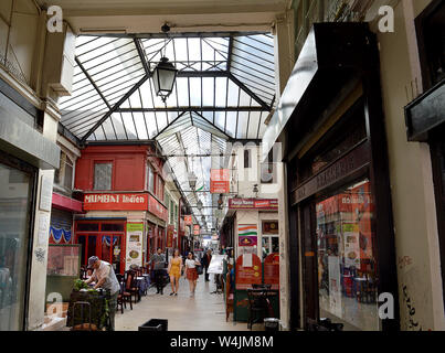 PARIS, FRANCE - 20 APRIL 2019:  Passage Brady off the rue du Faubourg-Saint-Denis is a covered arcade filled with Indian restaurants - Stock Photo