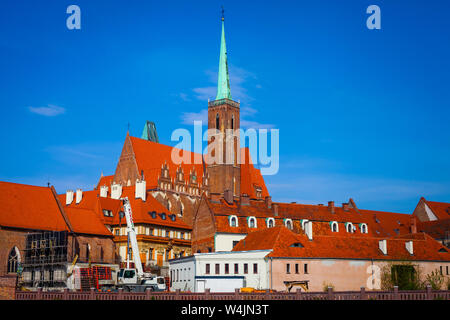 The Church of the Holy Cross in Ostrow Tumski, Wroclaw under blue skies - Stock Photo
