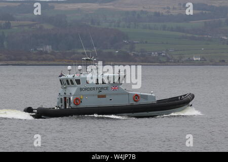 HMC Active, a coastal patrol vessel operated by the UK Border Force, passing East India Harbour on the Firth of Clyde. - Stock Photo