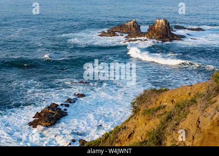 Early morning high-angle ocean view of Seal Rock in Laguna Beach, California. Seal Rock is an offshore wildlife habitat for shorebirds and sea lions. - Stock Photo