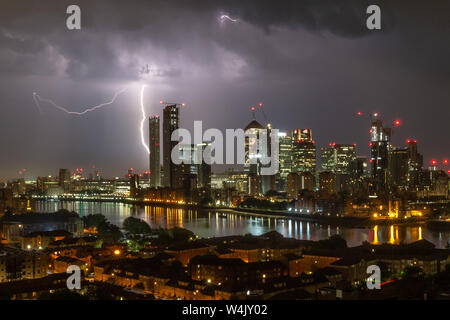 London, UK. 24th July, 2019. UK Weather: Lightning strikes over Canary Wharf. Credit: Guy Corbishley/Alamy Live News - Stock Photo