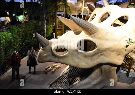 Los Angeles, USA. 22nd July, 2019. People visit 'Jurassic World' in Universal Studios Hollywood in Los Angeles, the United States, on July 22, 2019. Universal Studios Hollywood held a grand opening celebration on Monday night for its 'Jurassic World-The Ride,' a theme park which combines a new thrilling ride with attractions from the film 'Jurassic World.' Credit: Li Ying/Xinhua/Alamy Live News - Stock Photo