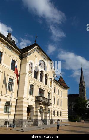 The Regierungsgebäude, or National Government Building, stands beside St. Florin's Cathedral in downtown Vaduz, Liechtenstein. - Stock Photo