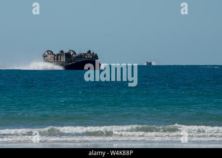 A Landing Craft Air Cushion from the Japanese Self Defense Force heads towards Langham Beach in Central Queensland as part of Exercise Talisman Sabre 2019. The purpose of Talisman Sabre 19 is to improve Australian-U.S. combat readiness and interoperability, maximize combined training opportunities and conduct maritime prepositioning and logistics operations. Exercises like this better prepare Australia and the U.S. for future conflict by fully integrating all domains of warfare (air, land, maritime, space and information). - Stock Photo