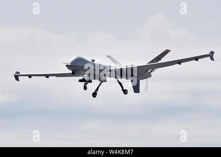 An MQ-9 Reaper assigned to the 214th Aircraft Maintenance Squadron, is in-flight after recently taking off during Northern Strike 19 at the Alpena Combat Readiness Training Center, Mich., July 22, 2019. Northern Strike 19 is a National Guard Bureau-sponsored exercise uniting approximately 5,700 service members and more than 20 states and seven coalition countries at the Camp Grayling Joint Maneuver Training Center and the Alpena CRTC, both located in Northern Michigan. (U.S. Air National Guard photo by Senior Airman Ryan Zeski) - Stock Photo