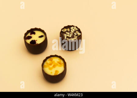 three chocolate filled bonbons sweets with selective focus - Stock Photo