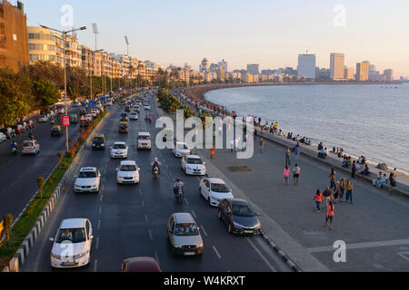 Late afternoon at Marine Drive, Mumbai, India, a boardwalk lining the Arabian Sea, a favorite sport for relaxation; seen from the Princess St. flyover - Stock Photo