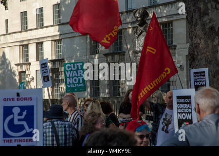 London, UK. 22nd 2019. Flags of the communist party near the statue of Field Marshal Montgomery at the demonstration  'Not My Prime Minister' in front of 10 Downing Street, protesting against the nomination of Prime Minister of the conservative Boris Johnson. Credit: Joe Kuis /Alamy News - Stock Photo