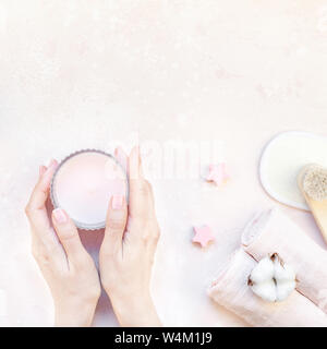 Spa, beauty cosmetics and body care treatment concept with copy space. Creative top view flat lay composition with candle in woman hands, bath accesso - Stock Photo