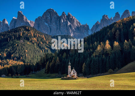 View on small Church of St. John in Ranui and Dolomite's mountains. Val di Funes. Italy, South Tyrol. Europe - Stock Photo