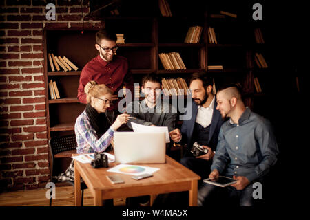 team of copywriters discussing a new advertising project in modern office - Stock Photo