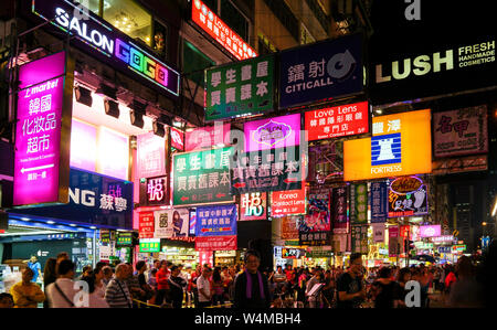 Kowloon, Hong Kong-Nov 6th, 2016: Lighted signboards and signs illuminated the streets of Kowloon. Hong Kong is famous for the myriad of neon lights a - Stock Photo