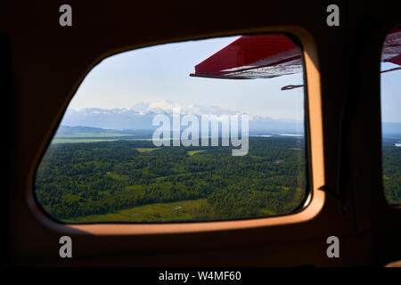 Panorama of Alaska seen from inside a small airplane - Stock Photo