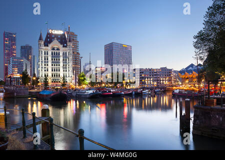 Rotterdam, Netherlands – June 26, 2019: Twilight view of the Oude Haven in Rotterdam with landmark Het Witte Huis at the left side and the famous cube