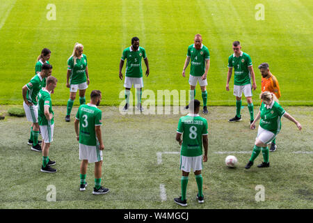 Players from the Northern Ireland men's and women's homeless football teams pass the ball to each other during a photocall at The National Stadium, Windsor Park, ahead of the teams departure tomorrow for the Homeless World Cup in Cardiff this coming weekend. - Stock Photo