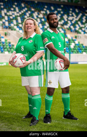 Northern Ireland's homeless woman's player, Janette Kelly (left), and Ahemd Elneel (right), captain of the Northern Ireland homeless football team, during a photocall at The National Stadium, Windsor Park, ahead of the teams departure tomorrow for the Homeless World Cup in Cardiff this coming weekend. - Stock Photo