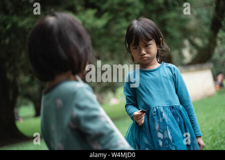 two little girls fighting over toys