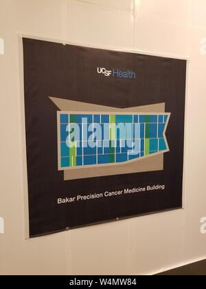 Close-up of sign for the newly-constructed Baker Precision Cancer Medicine Building at the University of California San Francisco (UCSF) medical center in Mission Bay, San Francisco, California, July 9, 2019. () - Stock Photo