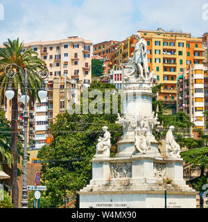 Christopher Columbus monument and colorful houses in Genoa, Italy. - Stock Photo