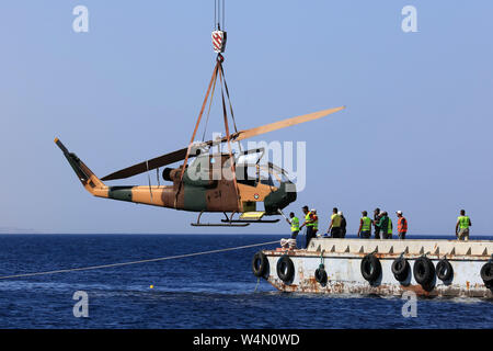 (190724) -- AMMAN, July 24, 2019 (Xinhua) -- A body of a military helicopter, donated by the Jordanian Royal Air Force, is submerged in the Red Sea off Aqaba, as part of a new underwater military museum, in south Jordan, July 24, 2019. The museum is built by Aqaba Special Economic Zone to attract more tourists in summer, (Photo by Mohammad Abu Ghosh/Xinhua) - Stock Photo