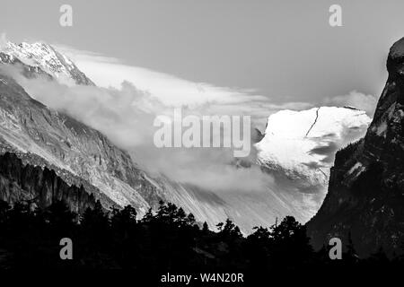 Black and white view of misty mountains. Morning in Himalayas, Nepal, Annapurna conservation area - Stock Photo