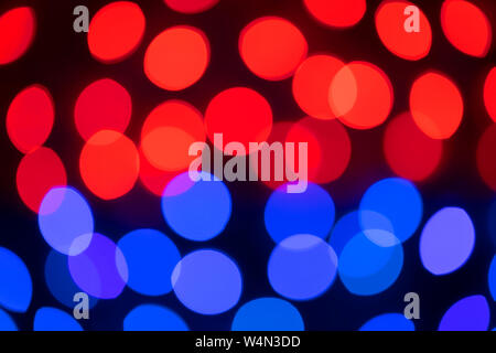 Blurred circles produced by a lens in the out of focus parts of an image. - Stock Photo