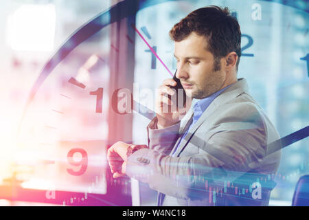 Business times concept. businessman calling smart mobile phone while looking what time at his wristwatch overlay clock face. - Stock Photo