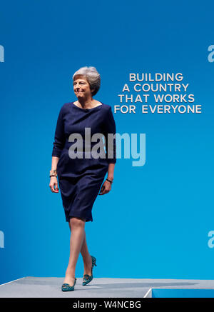 London, UK. 4th Oct, 2017. File photo taken on Oct. 4, 2017 shows British Prime Minister Theresa May walking to the stage to deliver her keynote speech on the last day of the Conservative Party Annual Conference in Manchester, Britain. Newly-elected Conservative Party leader Boris Johnson took office as the British prime minister on Wednesday amid the rising uncertainties of Brexit. The latest development came after Theresa May formally stepped down as the leader of the country and Johnson was invited by the Queen to form the government. Credit: Han Yan/Xinhua/Alamy Live News - Stock Photo
