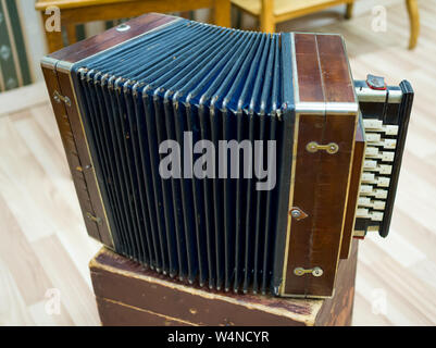 Russian accordion - an old national musical instrument - Stock Photo