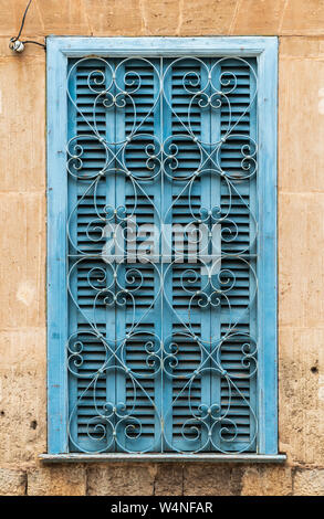 Turquoise window shutters with heart-shaped window grating in Valldemossa, Majorca, Spain - head-on view, vertical format - Stock Photo