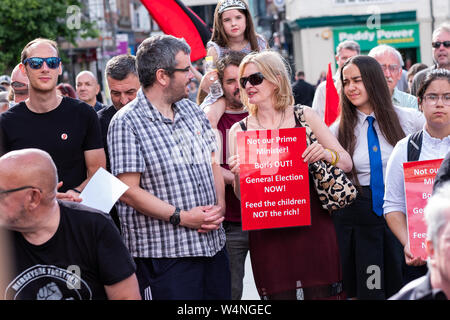 Liverpool, UK. July 24, 2019. Following today's proceedings in London where Boris Johnson took over from Theresa May as the Prime Minister of the United Kingdom, a rally was held in Williamson Square in Liverpool, north west England, against Boris Johnson becoming Prime Minster. Around 100 people attended, some holding banners and placards referring to the new Prime Minster, whilst some participants made speeches. Credit: Christopher Middleton/Alamy Live News - Stock Photo
