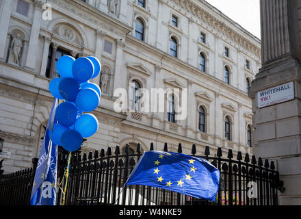 On the day that Britain's new Conservative Party Prime Minister, Boris Johnson enters Downing Street to begin his government administration, replacing Theresa May after her failed Brexit negotiations with the European Union in Brussels, pro-EU remainers protest outside Downing Street, on 24th July 2019, in Westminster, London, England. - Stock Photo