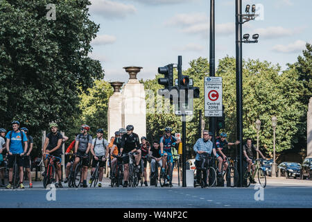 London, UK - July 15, 2019: Cyclists waiting on a red traffic light to cross a road in London, UK, in summer. Cycling is a popular way of getting arou - Stock Photo