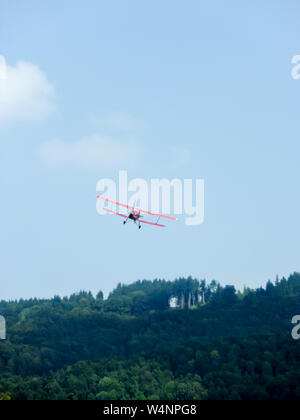 Antonov An-2 aircraft during airshow on an airfield in Switzerland - Stock Photo