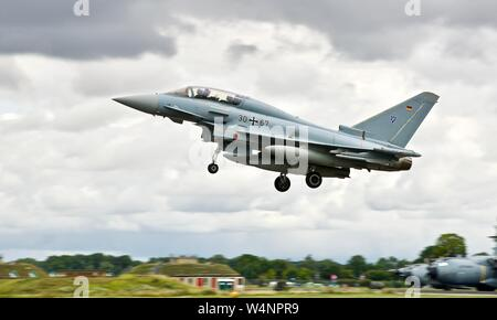 German Air Force Luftwaffe Eurofighter EF-2000 Typhoon fighter jet arriving at the 2019 Royal International Air Tattoo - Stock Photo