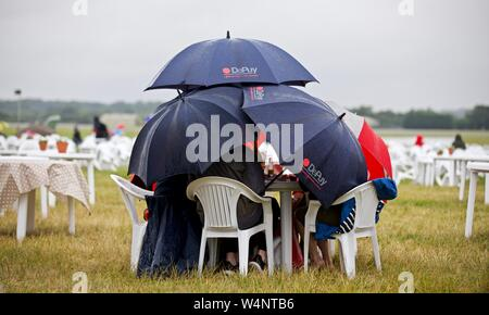 2019 Royal International Air Tattoo didn't start very well for the spectators but one group of friends where not going to be put off by the weather - Stock Photo
