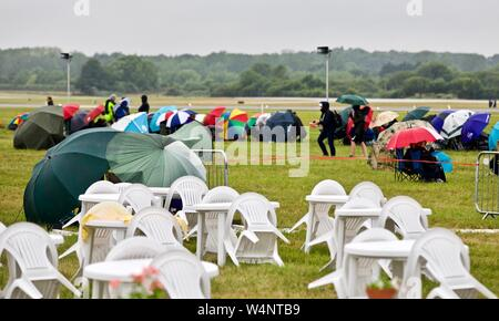 2019 Day one of the Royal International Air Tattoo didn't start very well for the spectators but the weather wasn't going to ruin their day - Stock Photo