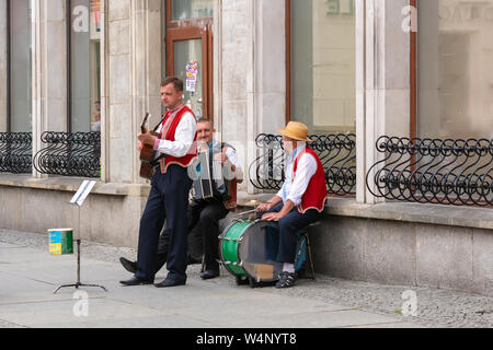 WROCLAW, POLAND - July 17, 2019: Street musicians on Market Square in Wroclaw. Poland - Stock Photo