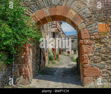 Conques, Midi Pyrenees, France - July 31, 2017: Old entrance arch to the medieval village of Conques in France - Stock Photo