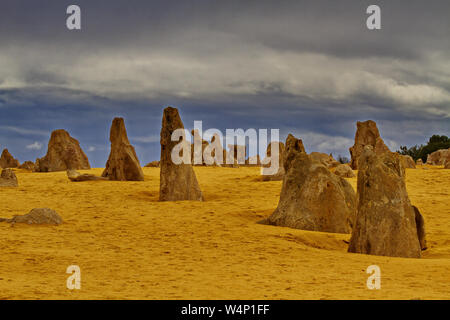 Evocative limestone formations of the Pinnacles Desert within the Nambung National Park of Western Australia. Horizontal image of weathered pillars an - Stock Photo